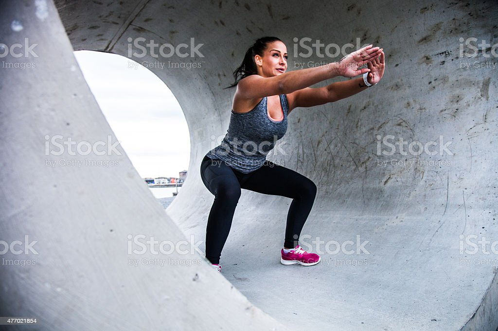 Healthy woman in early morning exercising in a tunnel stock photo