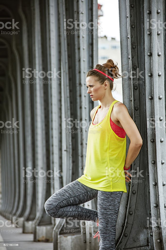 healthy woman looking into distance on Pont de Bir-Hakeim bridge stock photo