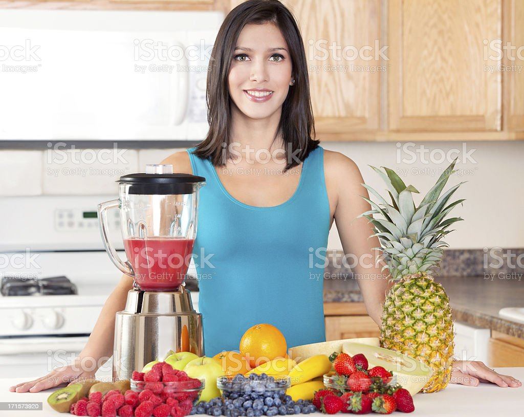 Healthy Woman Making Fresh Fruit Smoothie royalty-free stock photo