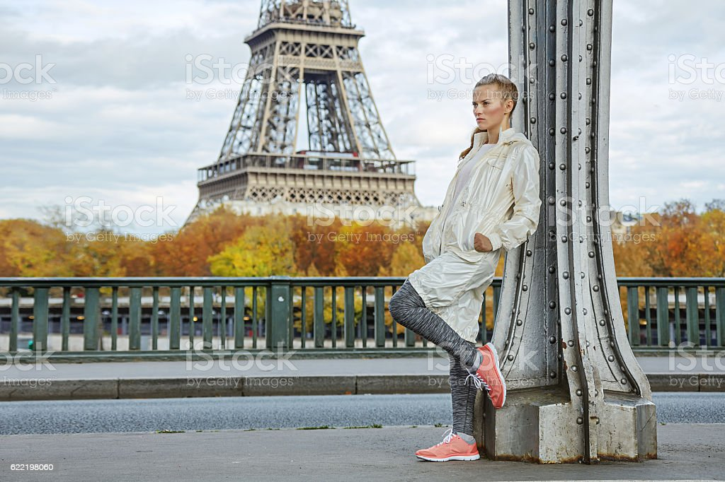 healthy woman on Pont de Bir-Hakeim bridge looking into distance stock photo