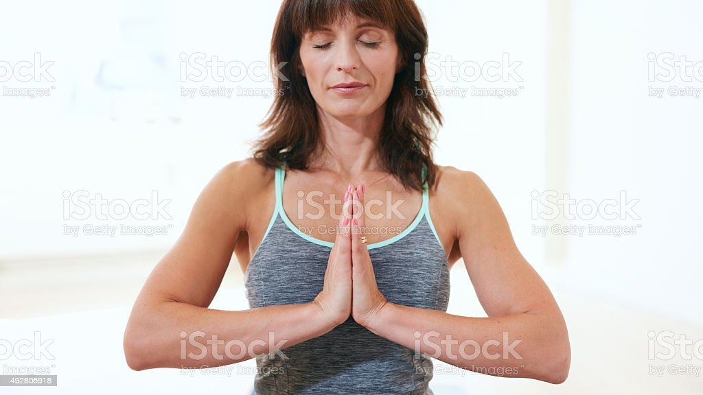 Healthy woman practicing meditation yoga stock photo