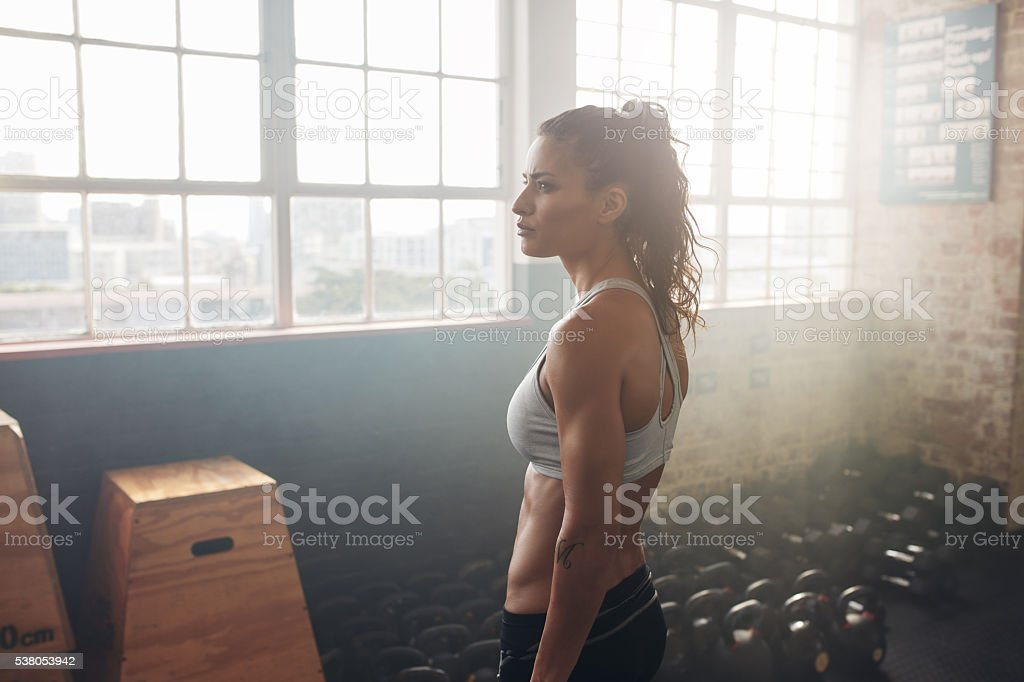 Healthy woman relaxing in the gym stock photo