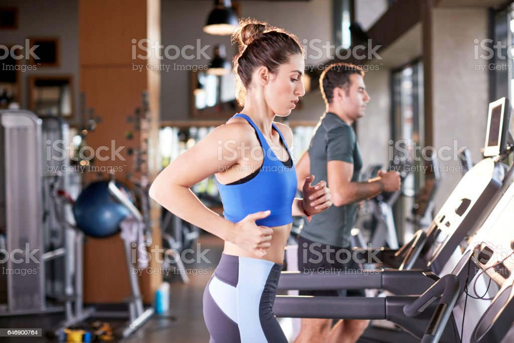 Healthy Woman Running on Treadmill stock photo