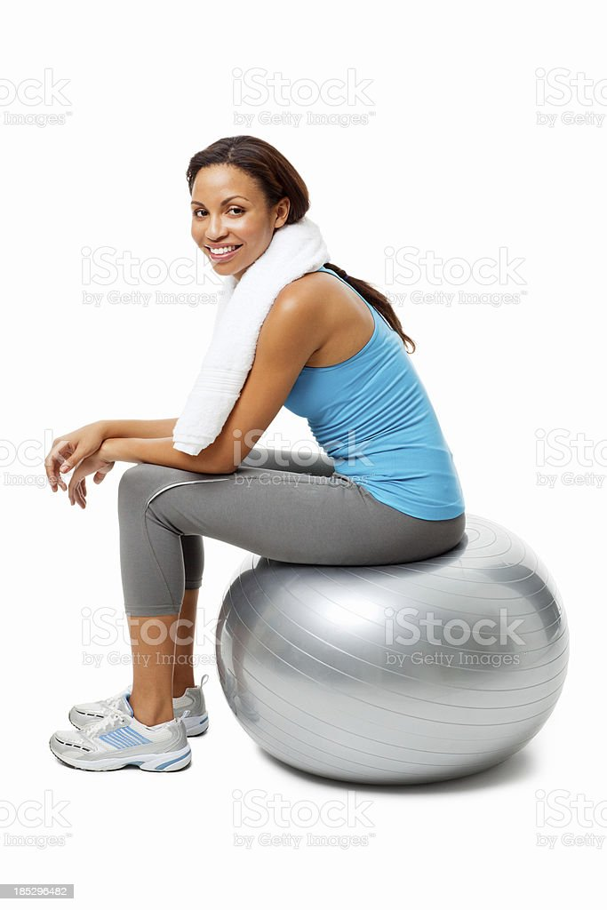Healthy Woman Sitting on Pilates Ball - Isolated royalty-free stock photo