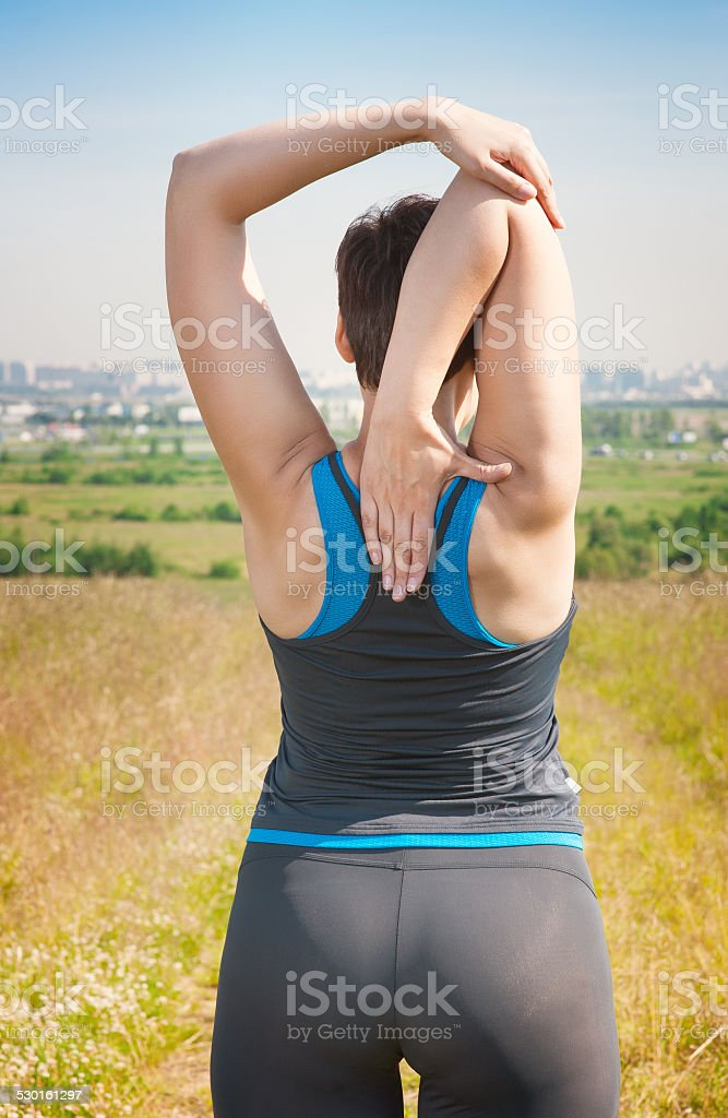 healthy woman stretching outdoor stock photo