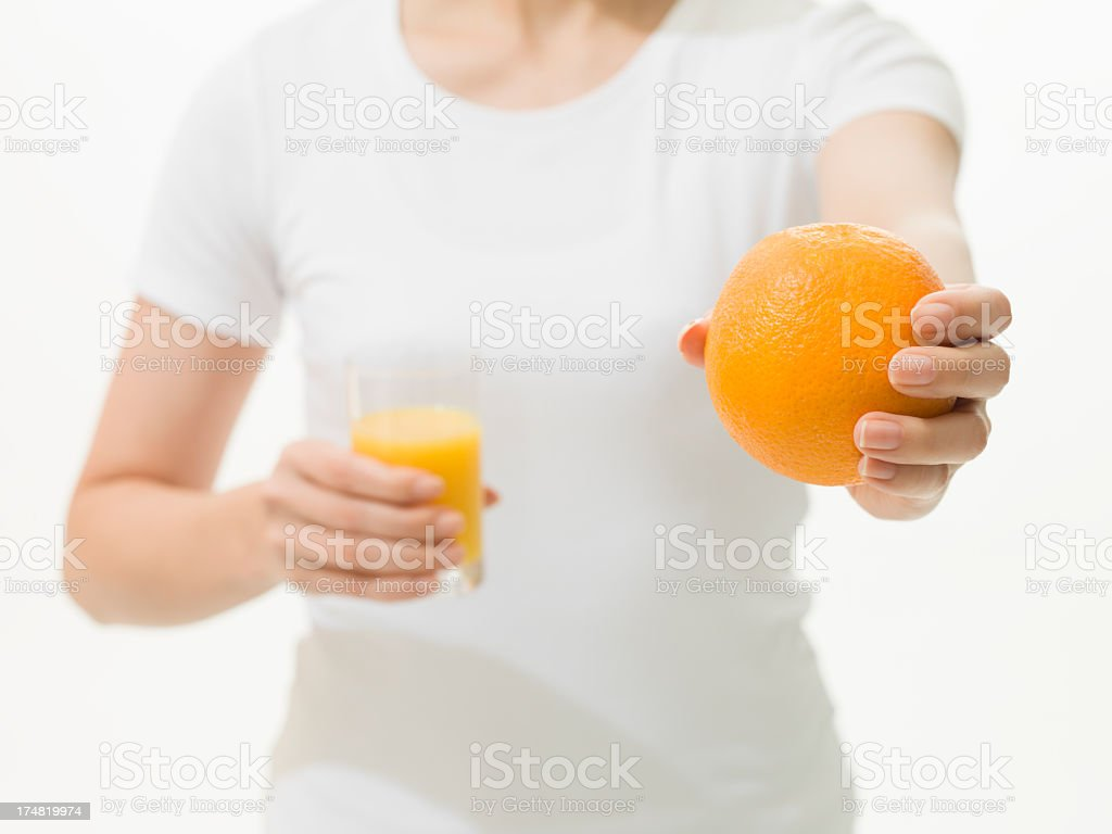 Healthy woman with orange. stock photo