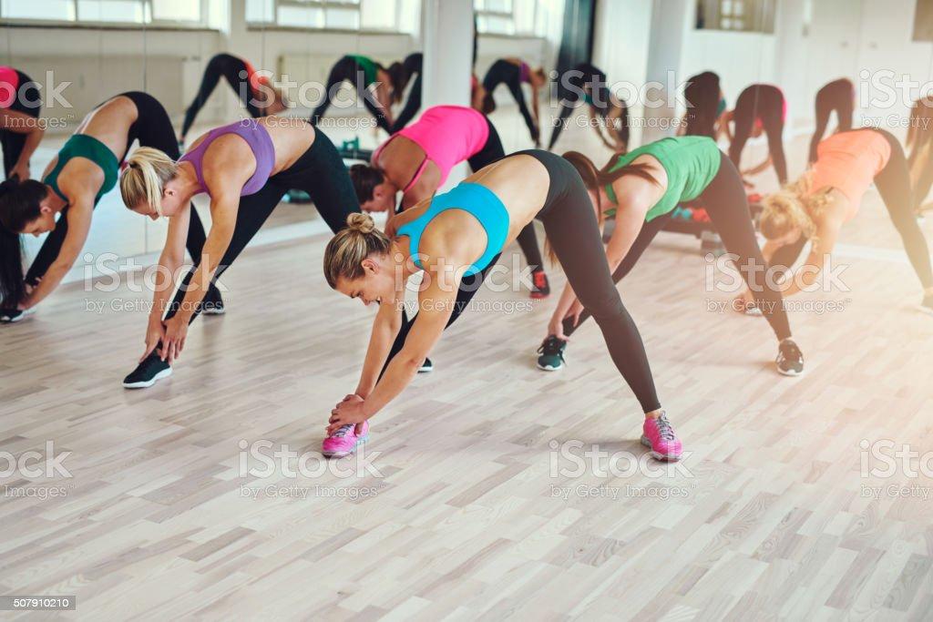 Healthy Women Exercising inside a Fitness Studio stock photo