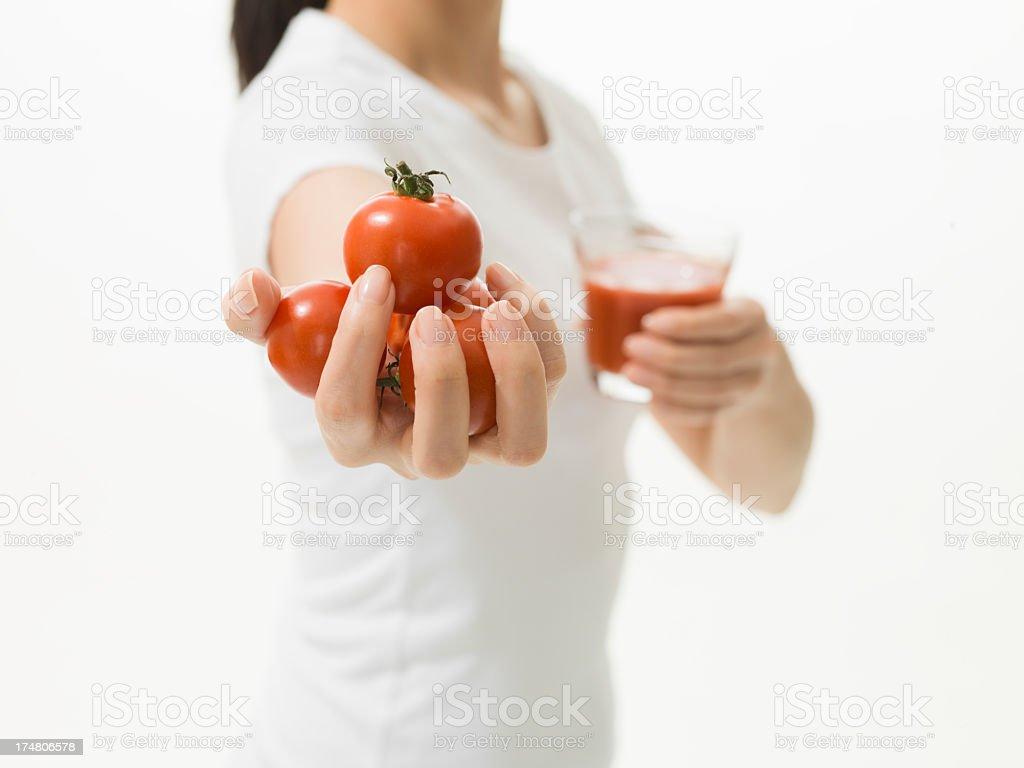 Healthy women hold tomatos and tomato juice royalty-free stock photo