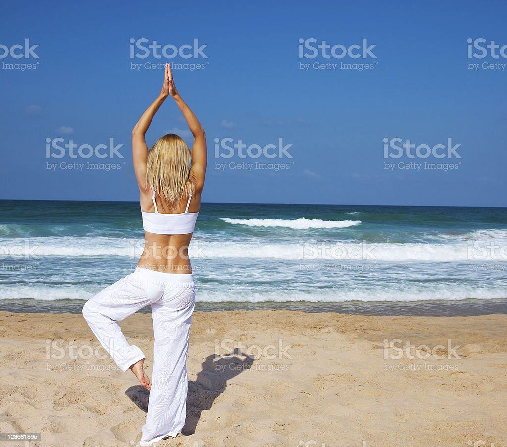 Healthy yoga exercise on the beach royalty-free stock photo