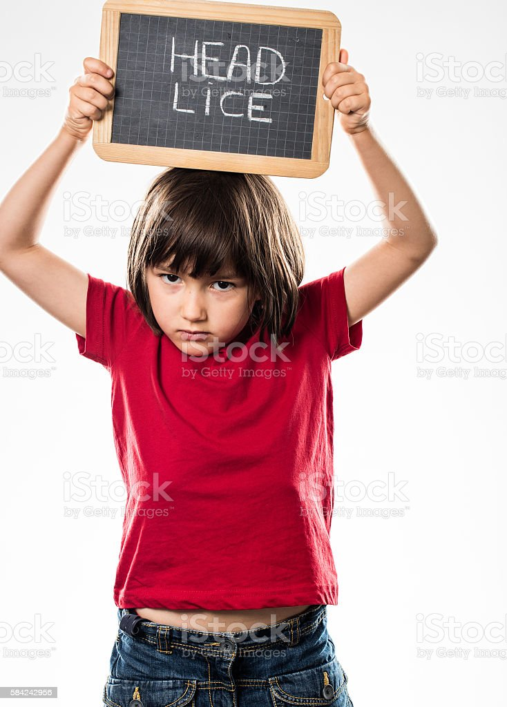 healthy young child holding school slate above head against enemies stock photo
