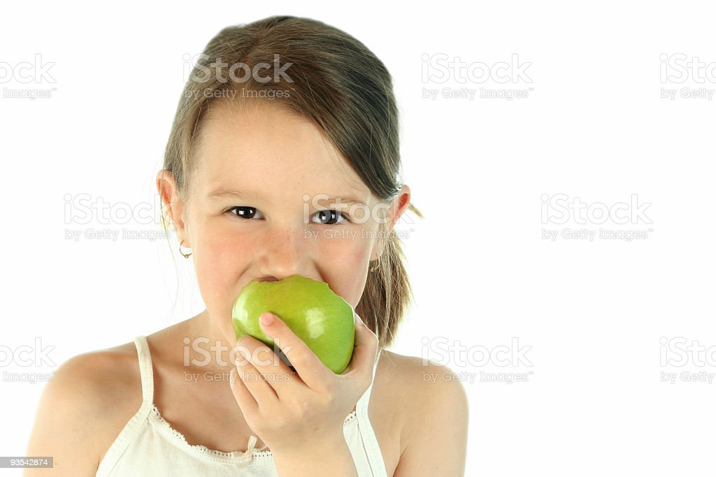 Healthy young girl eating apple, White Background royalty-free stock photo