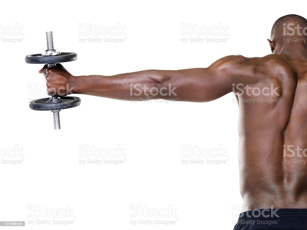 Healthy young guy doing shoulder exercise royalty-free stock photo