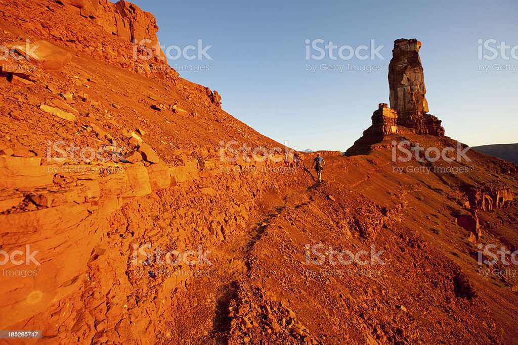 Healthy young man hiking at sunset in Utah near Moab royalty-free stock photo