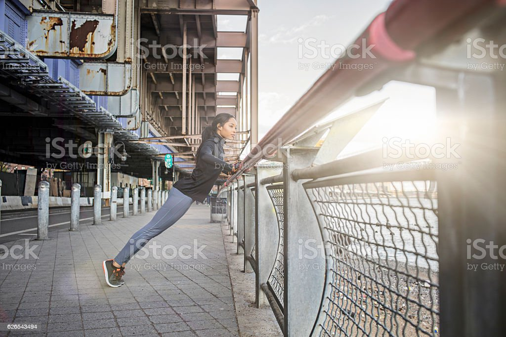 Healthy young woman doing stretching exercise stock photo