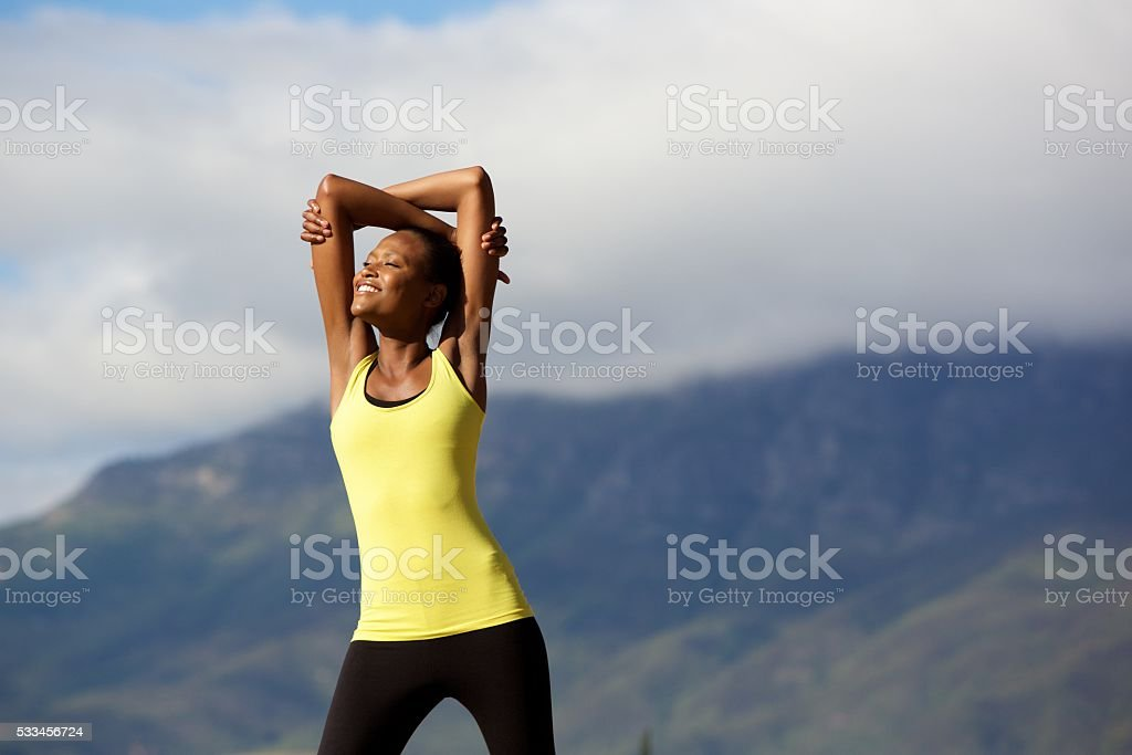 Healthy young woman doing stretching workout in nature stock photo