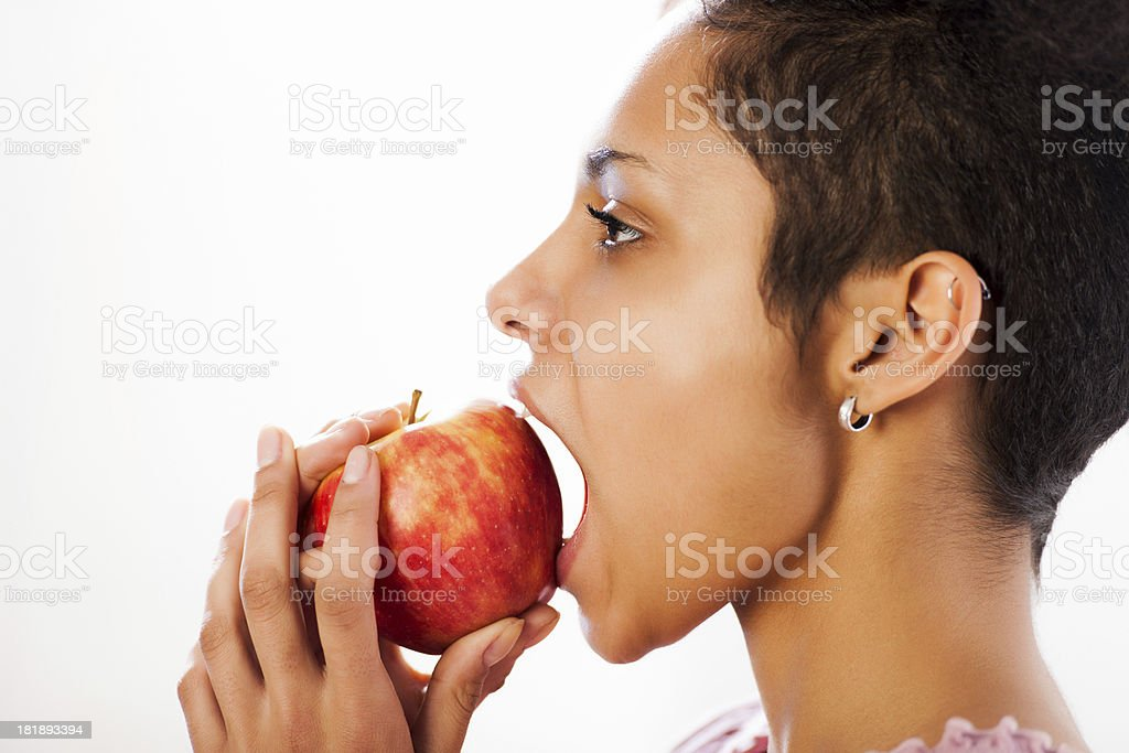 Healthy young woman eating an apple. royalty-free stock photo