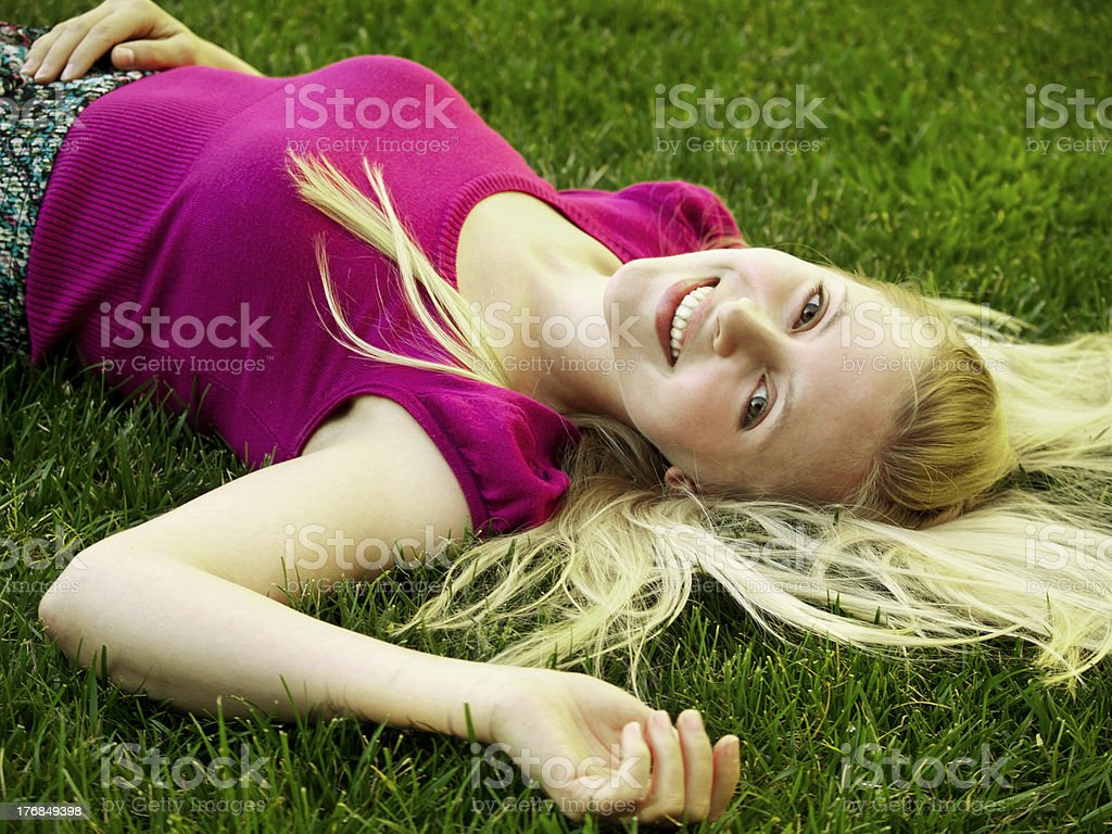Healthy Young Woman Laying on the Grass royalty-free stock photo