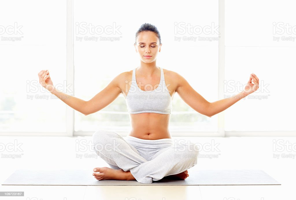 Healthy young woman practicing yoga royalty-free stock photo