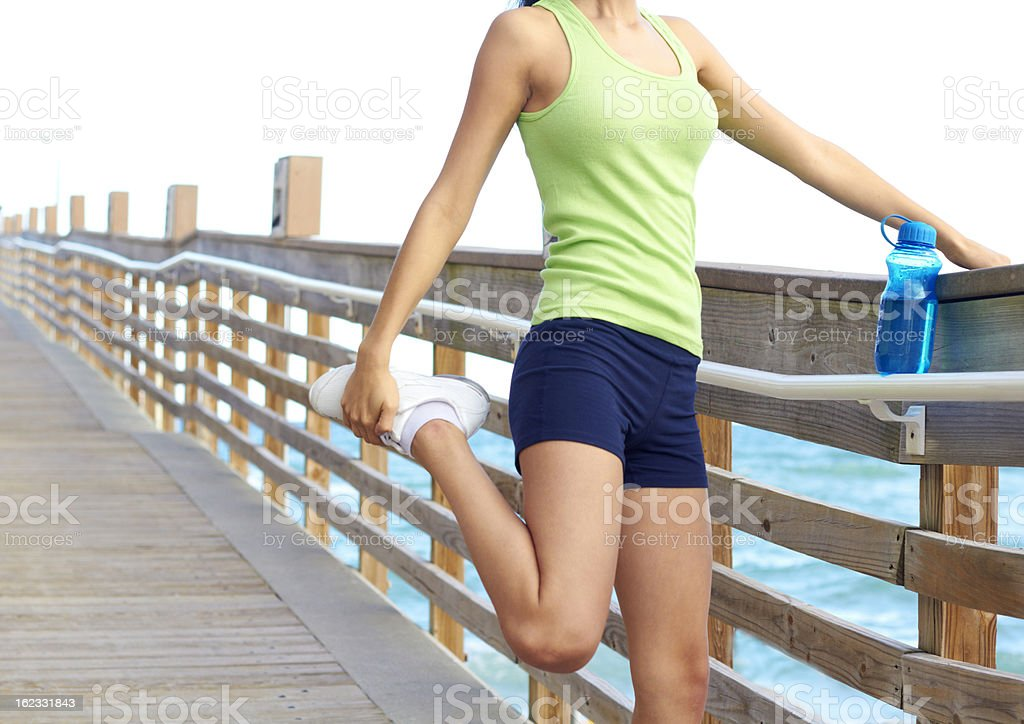Healthy Young Woman Stretching Her Leg stock photo