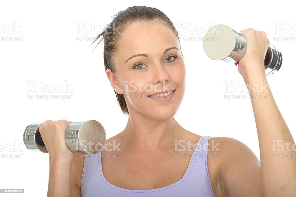 Healthy Young Woman Training With Dumb Bell Weights stock photo