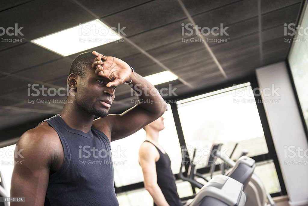 Healty lifestyle african athlete walking and setting Treadmill royalty-free stock photo