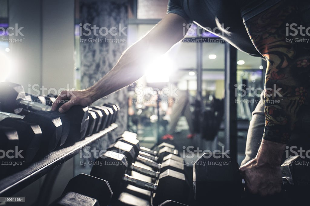 Healty Man Exercising with Arm Weights stock photo