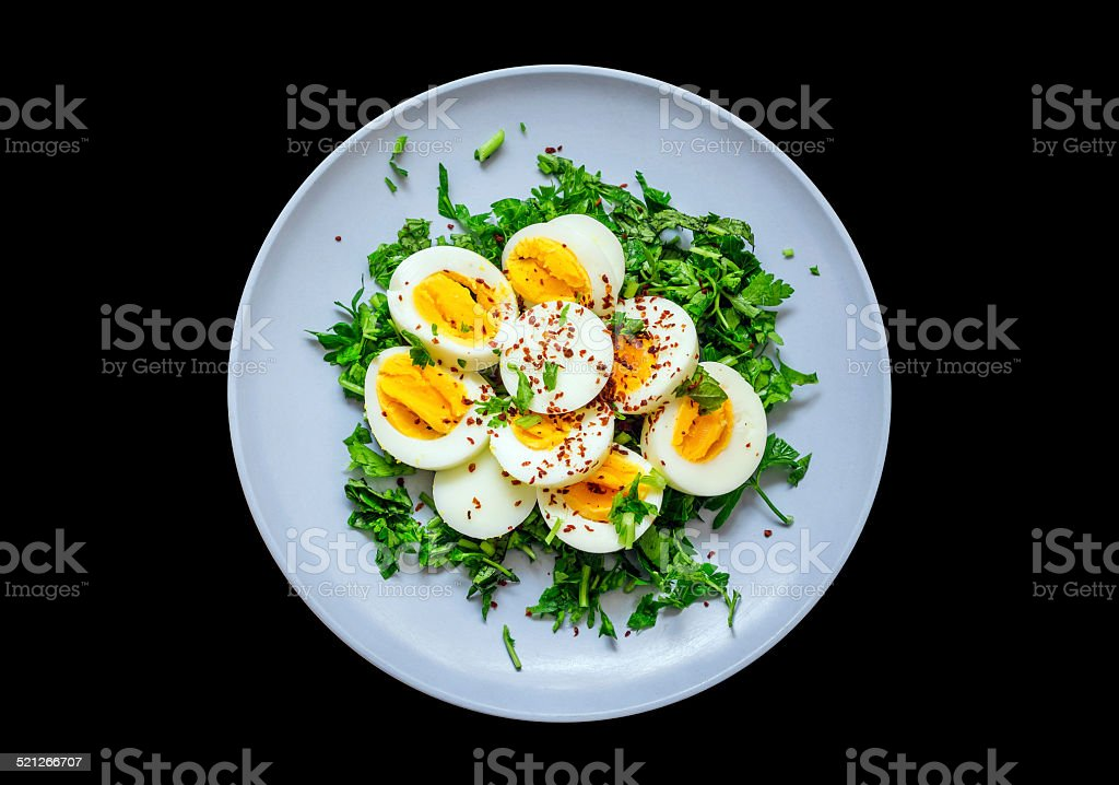 Healty salad with sliced eggs and some parsley stock photo