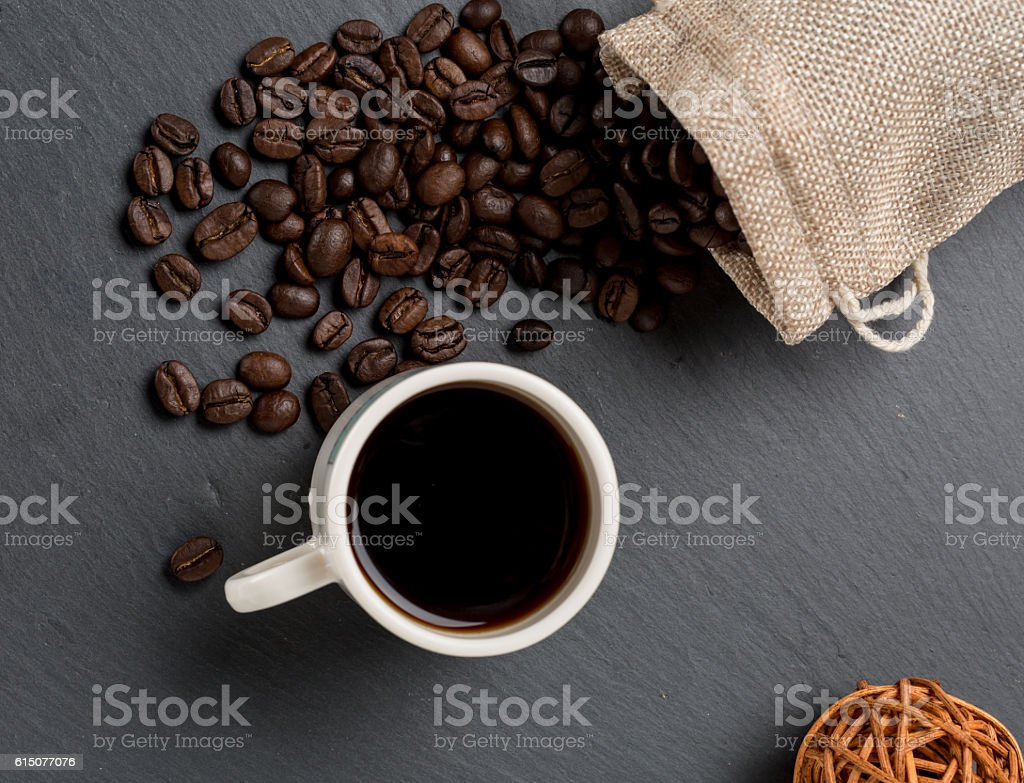 Heap coffe beans and cup of fresh coffee stock photo