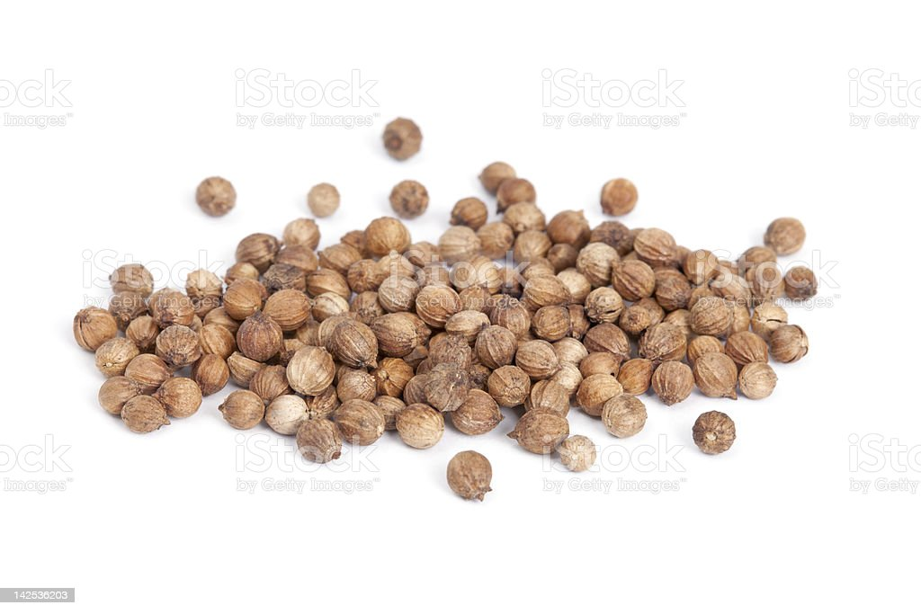 Heap Coriander Seeds (Coriandrum sativum) isolated on white back stock photo