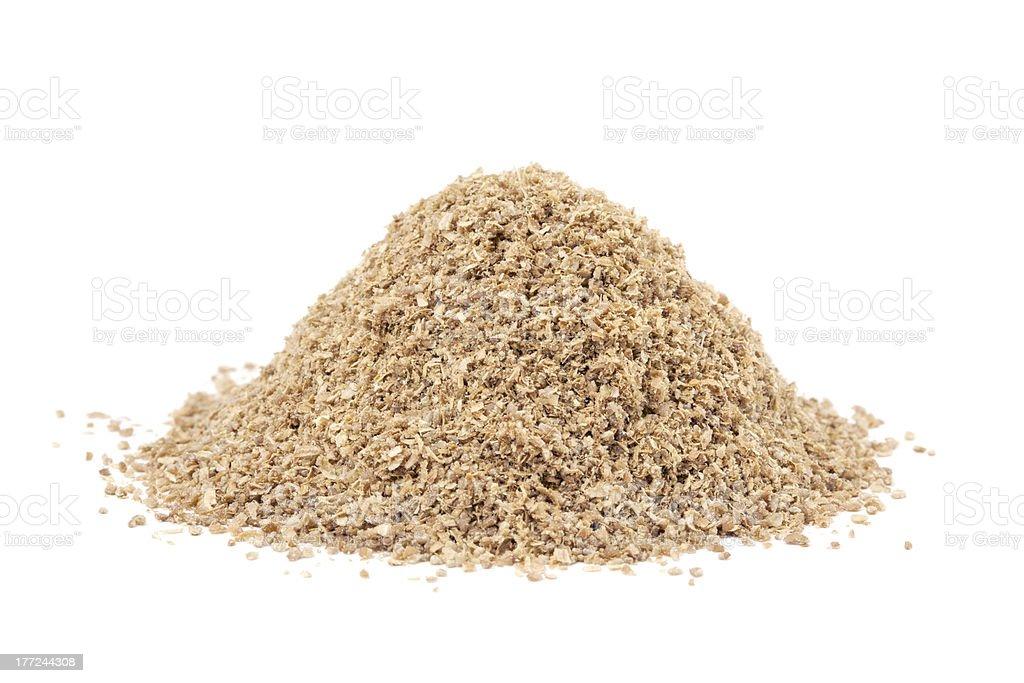 Heap ground Coriander (Coriandrum sativum) isolated on white stock photo