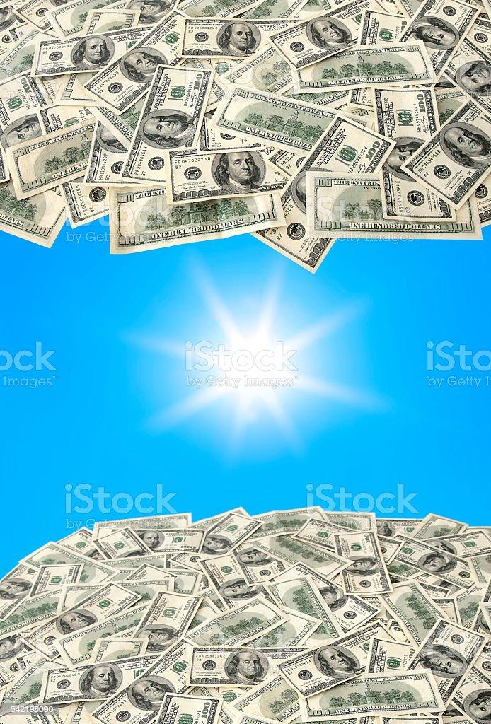 Heap of $100 banknotes and sunbeams stock photo