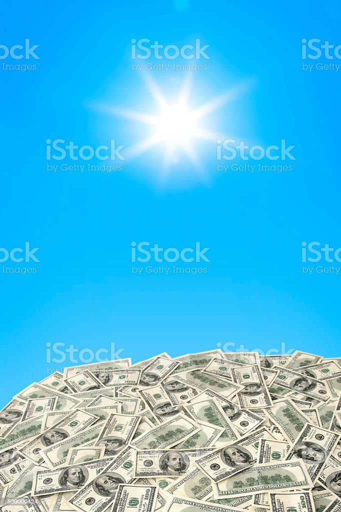 Heap of $100 banknotes under the sun stock photo