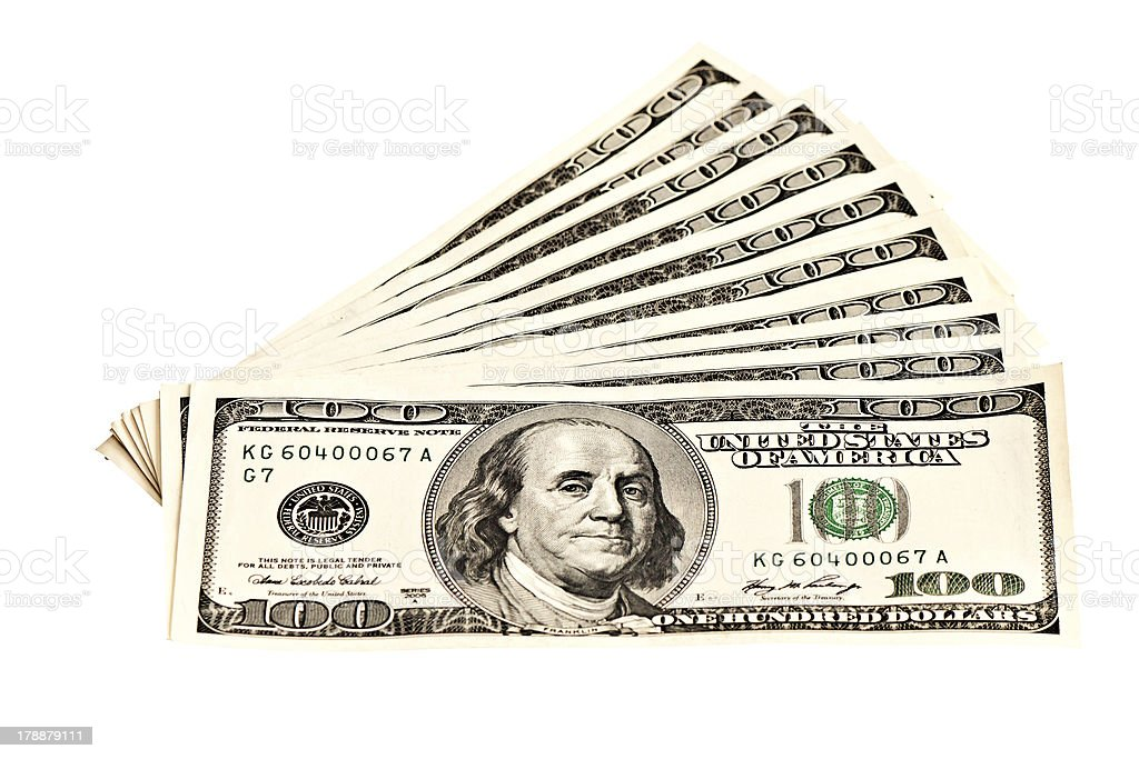 Heap of 100 dollar banknotes isolated on white royalty-free stock photo