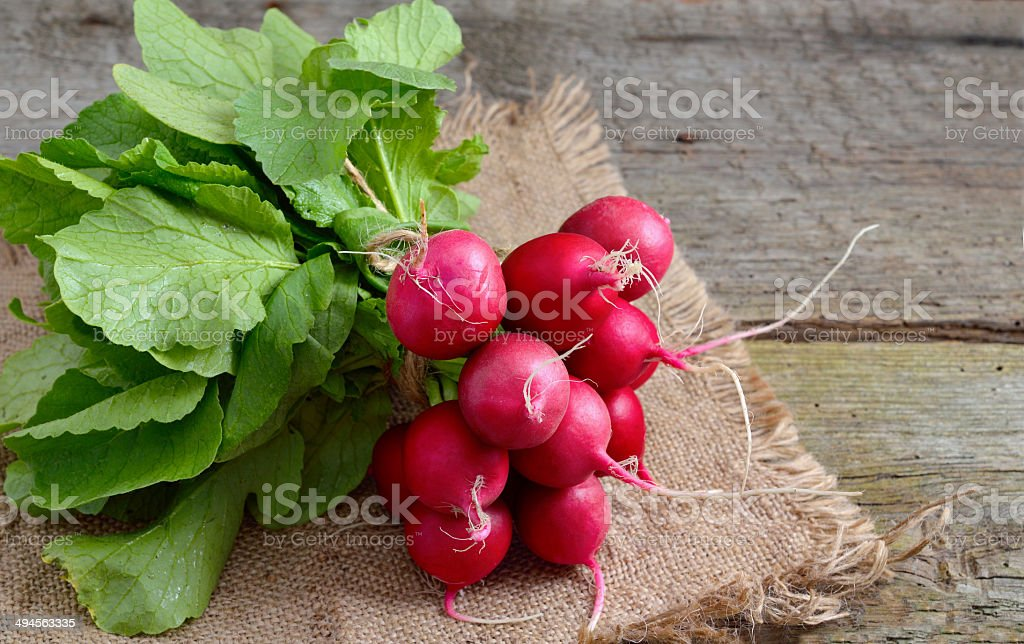 Heap of a garden radish on a wooden board stock photo