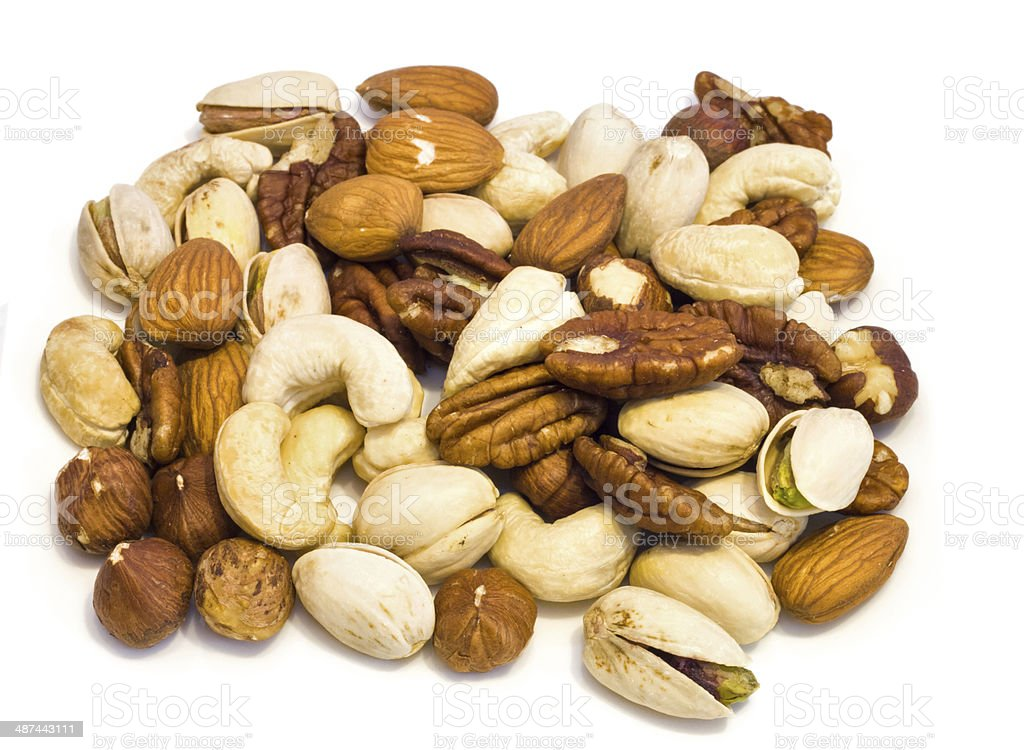 Heap of assorted nuts . stock photo