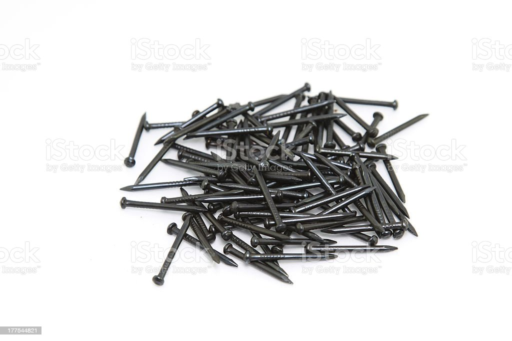 Heap of Black Concrete nails on white background royalty-free stock photo