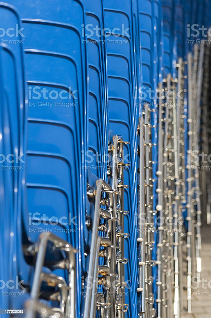 Heap of blue chairs royalty-free stock photo