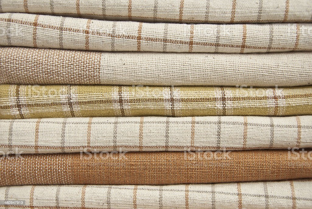 Heap of brown cotton fabric. royalty-free stock photo