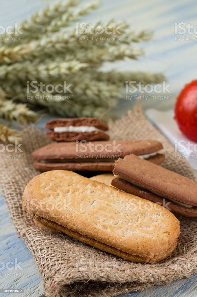 Heap of cereal biscuits on piece of burlap stock photo