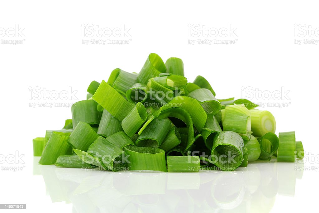 Heap of chopped green onions isolated on white background stock photo