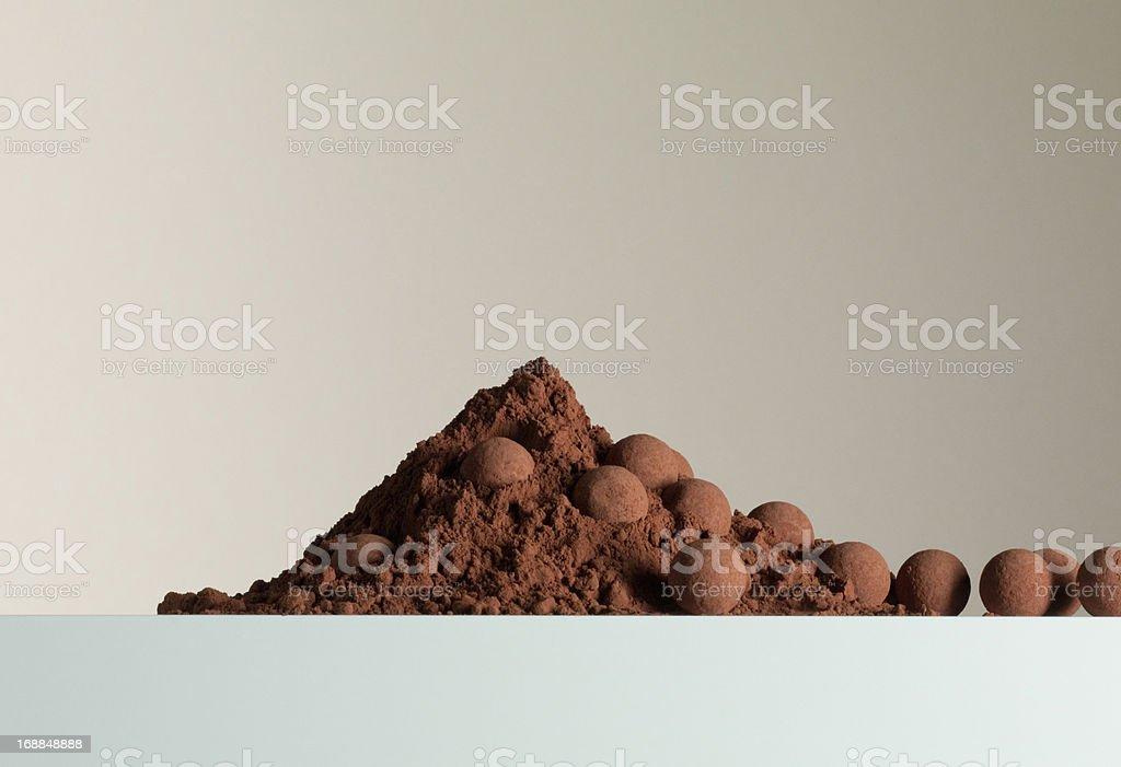 Heap of cocoa powder and truffles royalty-free stock photo