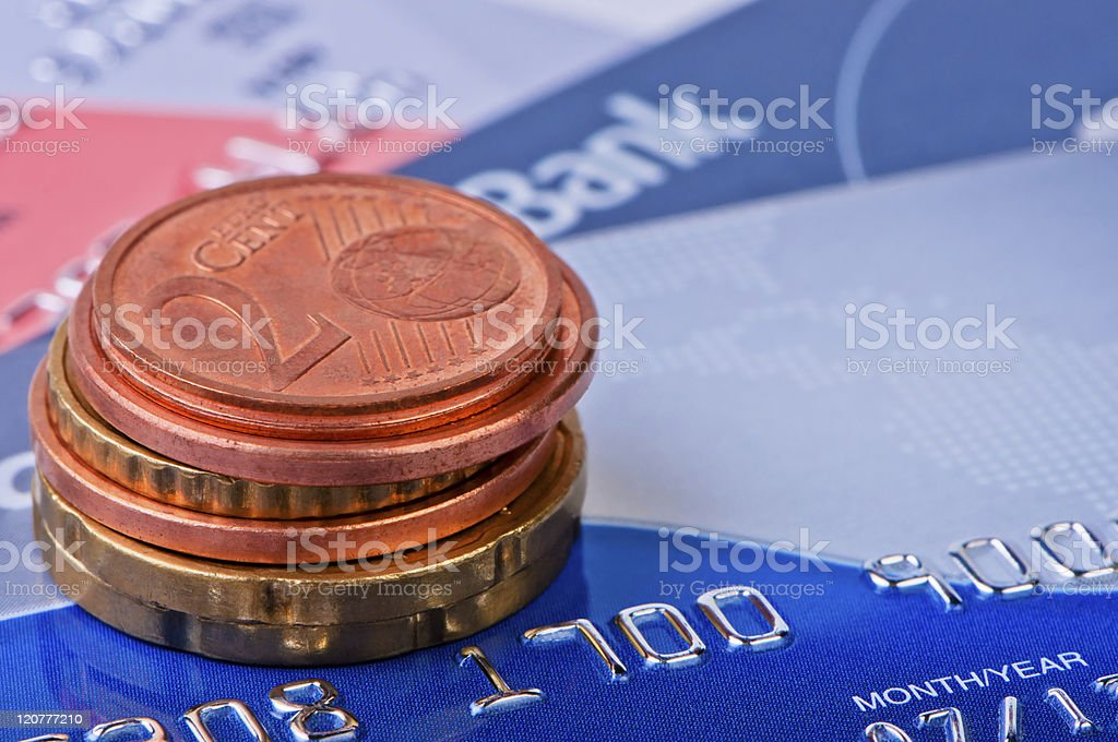 Heap of coins eurocents and credit cards. stock photo