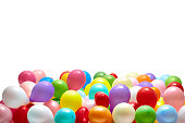 Heap of colorful balloons on white background studio shot
