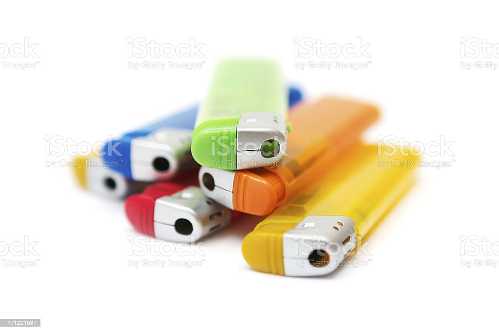 Heap of Colorful Cigarette Lighters stock photo