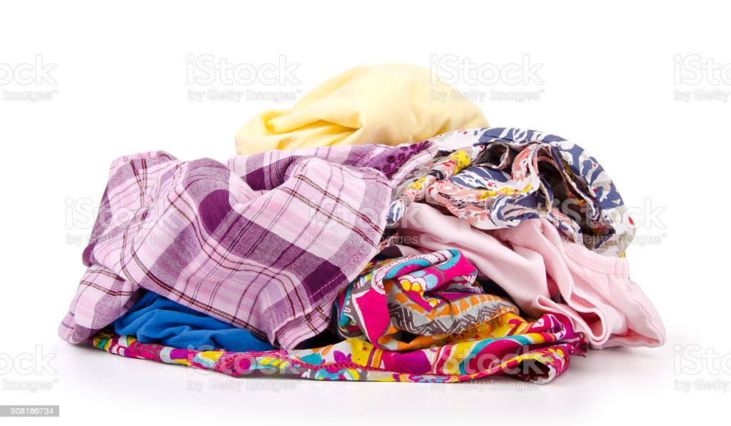 Heap of colorful clothes isolated on white stock photo