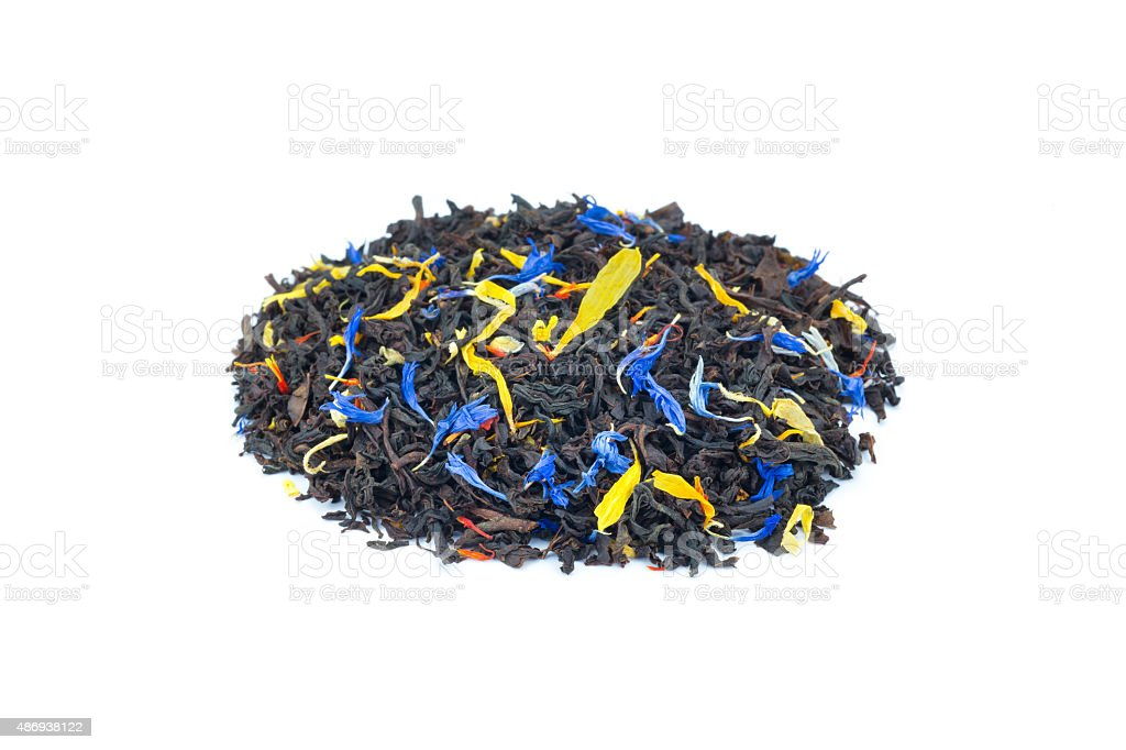 Heap of colorful loose exotic dream tea on white background stock photo