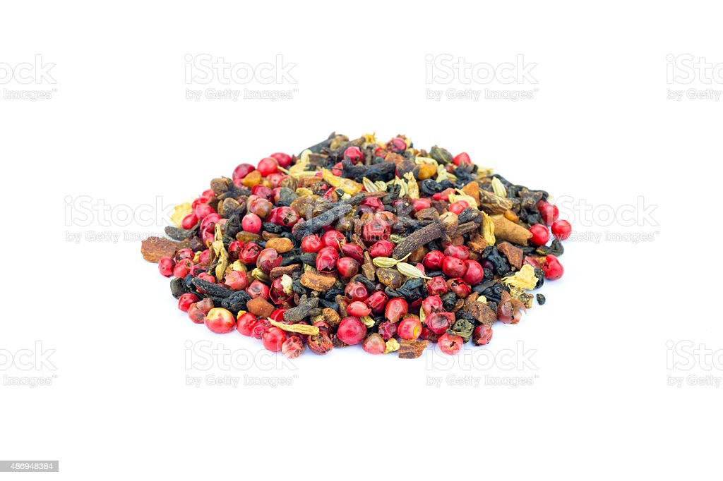 Heap of colorful loose green Chai tea on white background stock photo