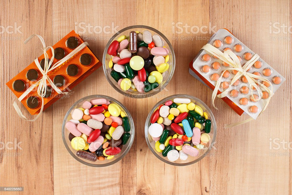 Heap of colorful medical pills and capsules, health care concept stock photo