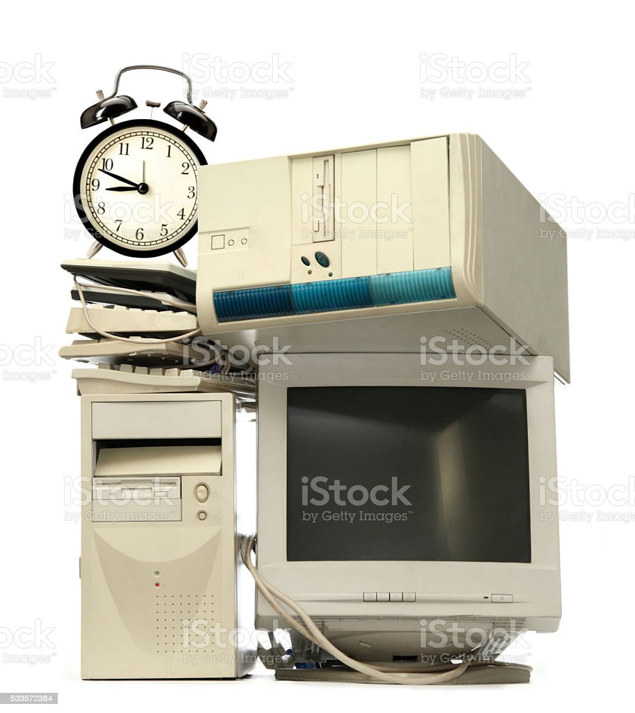 Heap of computers and alarm clock stock photo