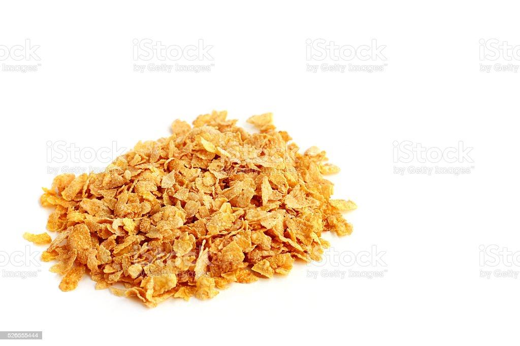 Heap of corn flakes on white background stock photo